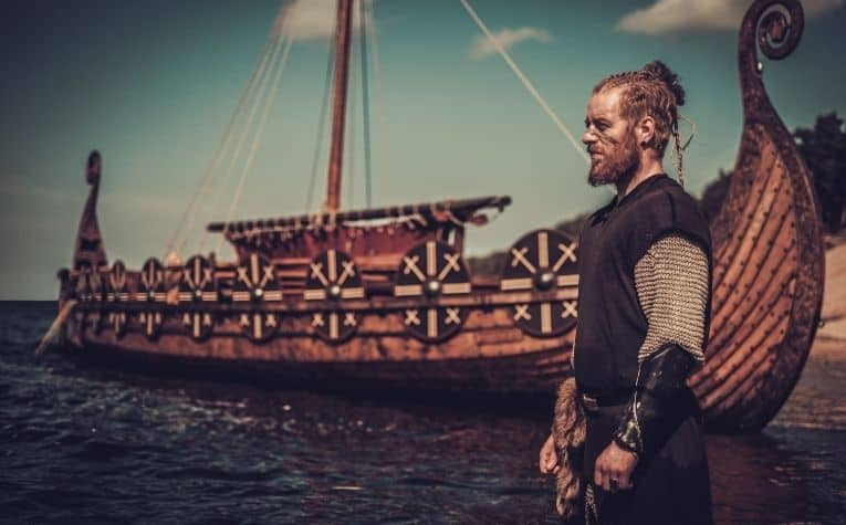 A viking alongside a longboat
