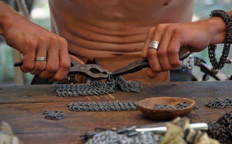 Viking making chainmail
