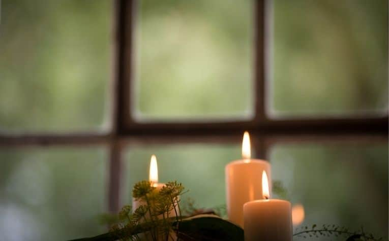 candles on a window sill