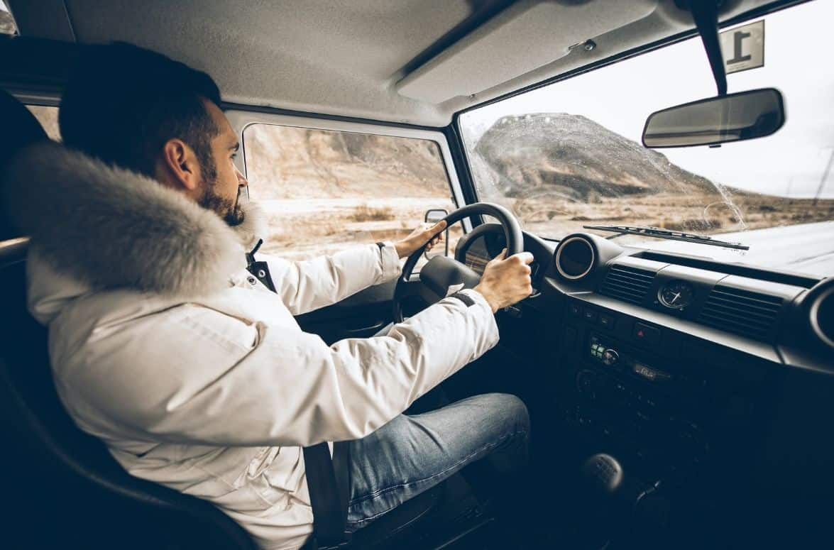 man driving in Iceland