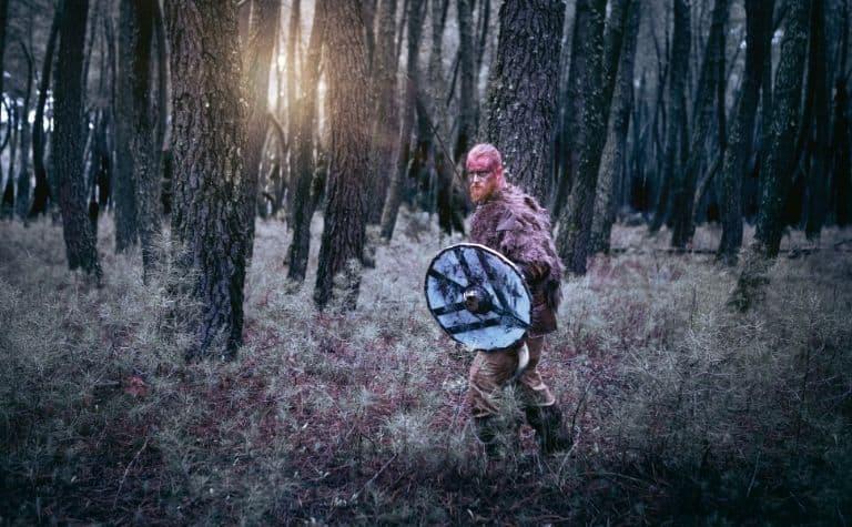 Viking man walking in the woods